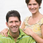 Smiling-man-and-woman-facing-camera-resized-150x150